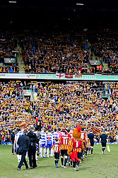 The teams make their way on to the pitch as the Bradford fans hold up their scarves - Photo mandatory by-line: Matt McNulty/JMP - Mobile: 07966 386802 - 07/03/2015 - SPORT - Football - Bradford - Valley Parade - Bradford City vReading - FA Cup - Quarter Final