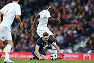 Scotland midfielder James Forrest (7) (Celtic)  is fouled by Portugal midfielder Danilo Pereira (13) (Porto) during the Friendly international match between Scotland and Portugal at Hampden Park, Glasgow, United Kingdom on 14 October 2018.