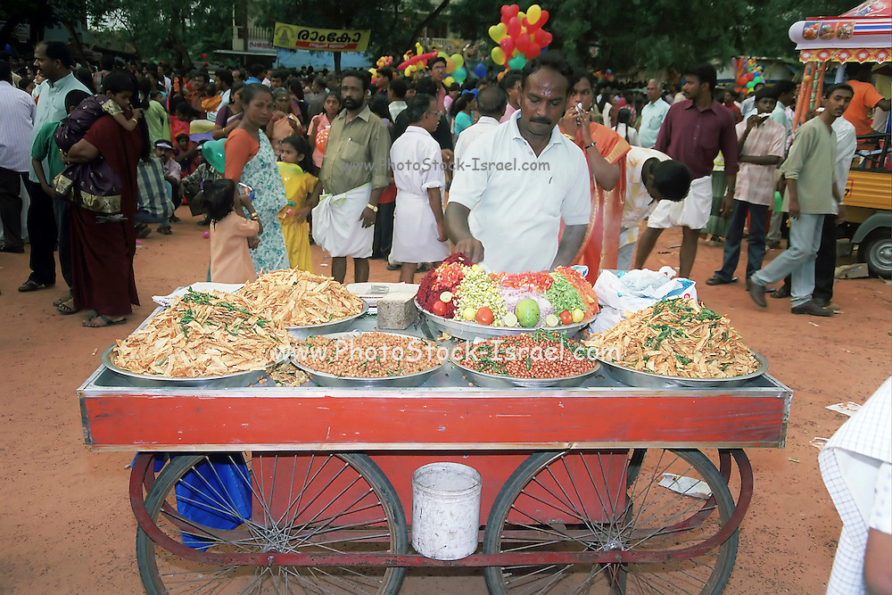 a men selling food from a mobile cart, India, Kerala, a state on the tropical coast of south west India