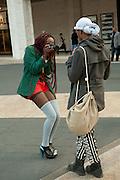 A fashionable photographer outside the fashion show