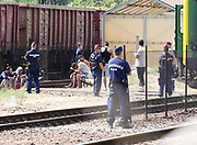 Migrants at Bicske train station in Hungary as a tense stand-off between police and migrants  continues into a second day. On Thursday, police let the migrants board the train in Budapest but then tried to force them off at a refugee camp to the west of the capital.  Picture by Paul Hackett