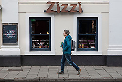 © Licensed to London News Pictures. 04/03/2019. Salisbury, UK. On the first anniversary of the poisoning of former Russian spy Sergei Skripal and his daughter Yulia a shopper passes Zizzi restaurant in Salisbury where they first became ill in March 2018. They both survived the nerve agent attack but a resident of nearby Amesbury, Dawn Sturgess, died in June 2018 after coming in contact with the poison. Two Russians have been named in connection with the attack. Photo credit: Peter Macdiarmid/LNP