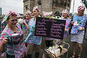Extinction Rebellion tea ladies take part in an Impossible Tea Party event on Tower Bridge after it was blocked using a caravan on 30th August 2021 in London, United Kingdom. Extinction Rebellion were drawing attention to financial institutions funding fossil fuel projects whilst calling on the UK government to cease all new fossil fuel investment with immediate effect on the eighth day of their Impossible Rebellion protests in London.
