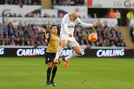 Jonjo Shelvey of Swansea city gets in ahead of Alexis Sanchez of Arsenal to win the ball. Barclays Premier league match, Swansea city v Arsenal  at the Liberty Stadium in Swansea, South Wales  on Saturday 31st October 2015.<br /> pic by  Andrew Orchard, Andrew Orchard sports photography.