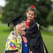 """25.08.2016          <br />  Faculty of Business, Kemmy Business School graduations at the University of Limerick today. <br /> <br /> Attending the conferring was Certificate in Management graduate, Majella Hall, Ballinacurra Terrace, Limerick with her daughter 5 year old Rebecca. Picture: Alan Place.<br /> <br /> <br /> As the University of Limerick commences four days of conferring ceremonies which will see 2568 students graduate, including 50 PhD graduates, UL President, Professor Don Barry highlighted the continued demand for UL graduates by employers; """"Traditionally UL's Graduate Employment figures trend well above the national average. Despite the challenging environment, UL's graduate employment rate for 2015 primary degree-holders is now 14% higher than the HEA's most recently-available national average figure which is 58% for 2014"""". The survey of UL's 2015 graduates showed that 92% are either employed or pursuing further study."""" Picture: Alan Place"""