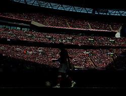 Bristol City's Luke Freeman's silhouette walks in front of the Bristol City fans in sun light  - Photo mandatory by-line: Joe Meredith/JMP - Mobile: 07966 386802 - 22/03/2015 - SPORT - Football - London - Wembley Stadium - Bristol City v Walsall - Johnstone Paint Trophy Final
