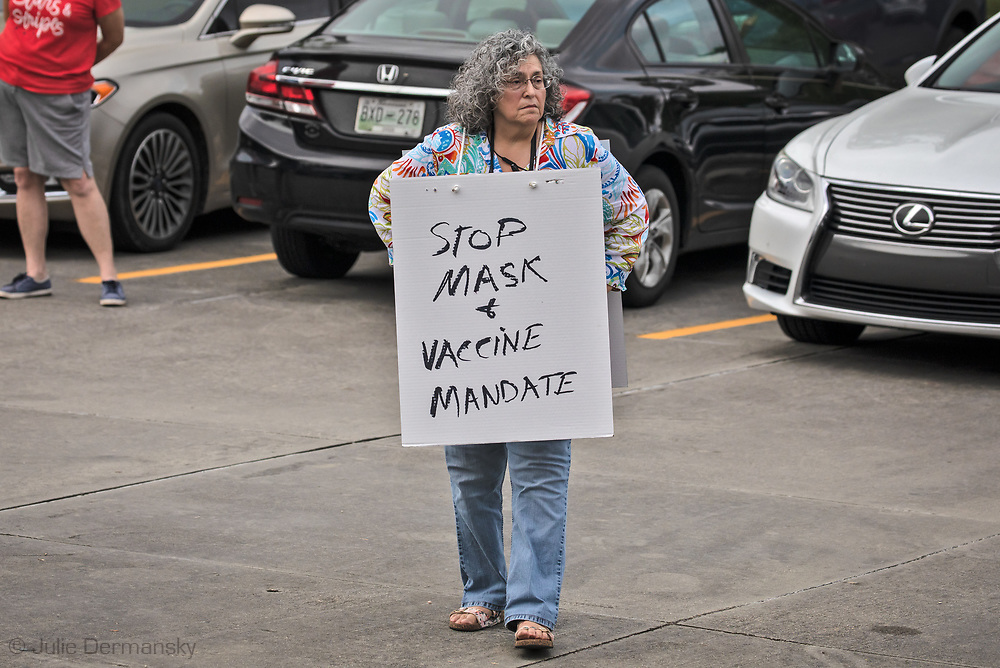 Roxana Buckingham protests Louisiana's mask mandate outside of the Robert Brooks Educational Center in Slidell where a St. Tammany School Board meeting was held on August 12
