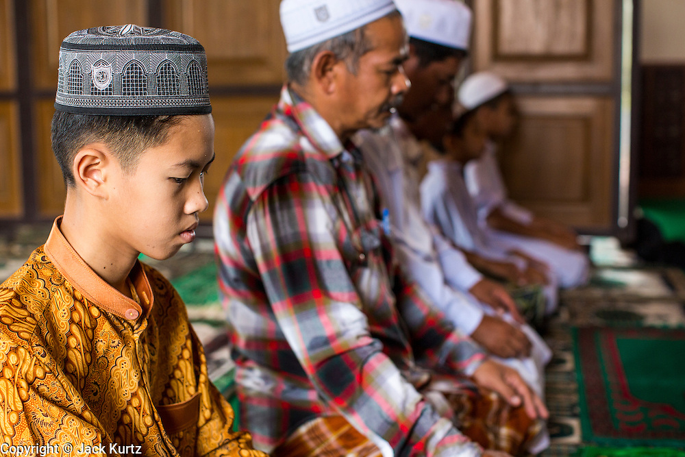 24 OCTOBER 2012 - PATTANI, PATTANI, THAILAND: Men pray in the Krue Se Mosque in Pattani, Thailand. More than 5,000 people have been killed and over 9,000 hurt in more than 11,000 incidents, or about 3.5 a day, in Thailand's three southernmost provinces and four districts of Songkhla since the insurgent violence erupted in January 2004, according to Deep South Watch, an independent research organization that monitors violence in Thailand's deep south region that borders Malaysia. Muslim extremists are battling the Thai government and its symbols, like schools and Buddhist facilities.    PHOTO BY JACK KURTZ