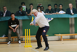 © Licensed to London News Pictures. 10/07/2015. London, UK. Boris Johnson takes part in a street cricket tournament in Uxbridge, London on Friday, July 10, 2015. The Mayor of London playing the game to support grassroots sports for community cohesion as the Ashes gets under way. Photo credit: Tolga Akmen/LNP