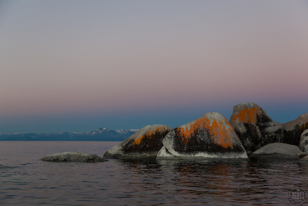 """""""Tahoe Boulders at Sunrise 7"""" - These orange, black, and grey boulders were photographed at sunrise from a kayak near Speedboat Beach, Lake Tahoe."""