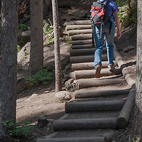 A hikers ascends the Ouzel Falls trail in the Madison Range near Big Sky, Montana