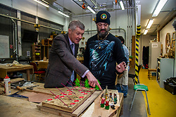 """Pictured: Willie Rennie gets up close and personal with Student Robert McGee who is in the Christmas spirt early<br /><br />Scottish Liberal Democrat Leader Willie Rennie visited the Future Energy Skills centre at Fife College in Glenrothes today to argue for """"astronomical investment"""" in home insulation to tackle the climate emergency and end fuel poverty by 2025 . <br /><br /><br /><br />Ger Harley 