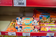 12 MARCH 2013 - ALONG HIGHWAY 13, LAOS: American style snacks for sale in the Sanetronic, a Chinese department store in Oudomaxy. The Chinese market in Oudomaxy is still under construction but much of the market is empty. Oudomaxy has a large Chinese immigrant community. By some estimates, as much as 40% of the people now living in the town are originally from China, most from the province Yunnan in southern China. The paving of Highway 13 from Vientiane to near the Chinese border has changed the way of life in rural Laos. Villagers near Luang Prabang used to have to take unreliable boats that took three hours round trip to get from the homes to the tourist center of Luang Prabang, now they take a 40 minute round trip bus ride. North of Luang Prabang, paving the highway has been an opportunity for China to use Laos as a transshipping point. Chinese merchandise now goes through Laos to Thailand where it's put on Thai trains and taken to the deep water port east of Bangkok. The Chinese have also expanded their economic empire into Laos. Chinese hotels and businesses are common in northern Laos and in some cities, like Oudomxay, are now up to 40% percent. As the roads are paved, more people move away from their traditional homes in the mountains of Laos and crowd the side of the road living off tourists' and truck drivers.    PHOTO BY JACK KURTZ