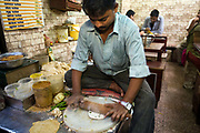 Ram Billas making paratha at Parawthe Wala restaurant in Old Delhi, India<br /> Gali Paranthe Wali or Paranthe wali Gali means the the street of fried bread and name of a narrow street in Chandni Chowk Old Delhi, noted for its series of shops selling paratha. The parantha is an Indian fried bread, folded and filled with fillings and then fried