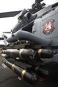 Hellfire missiles on racks of a Sikorsky MH-60R helicopter at the Farnborough Airshow. ..The MH-60R is the U.S. Navy's newest and most advanced multi-mission helicopter, designed for anti-submarine and surface warfare (ASW/ASuW). Secondary missions include: Search and Rescue, anti-ship surveillance and targeting, communication relay and medevac/vertical replenishment. The Sikorsky-built helicipter with integrated avionics and mission systems by Lockheed Martin.