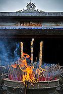Flames of burning incense sticks in Thien Mu pagoda, Hue, Vietnam, Southeast Asia