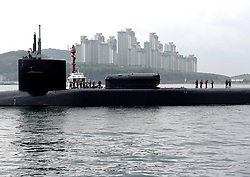 April 24, 2017 - Busan, South Korea - The U.S. Navy Ohio-class guided-missile submarine USS Michigan comes into port for supplies April 24, 2017 in Busan, South Korea. The Michigan is armed with 150 Tomahawk missiles and is paying a port visit to South Korea as tensions continue to rise between the U.S. and North Korea. (Credit Image: © Jermaine Ralliford/Planet Pix via ZUMA Wire)
