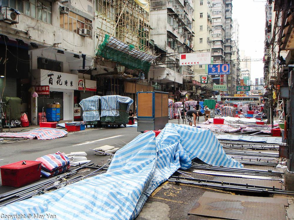 Vendors prepare their stores along a street in Hong Kong.