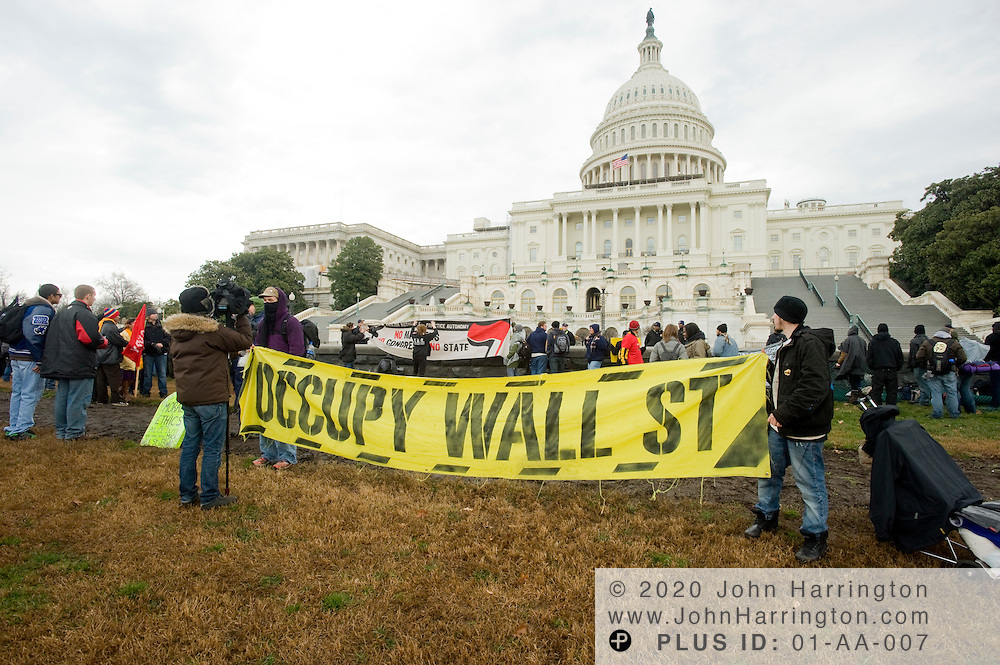 Occupy wall street banner is displayed by Occupy DC protesters on the grounds of the US Capitol, Tuesday January 17,2012.