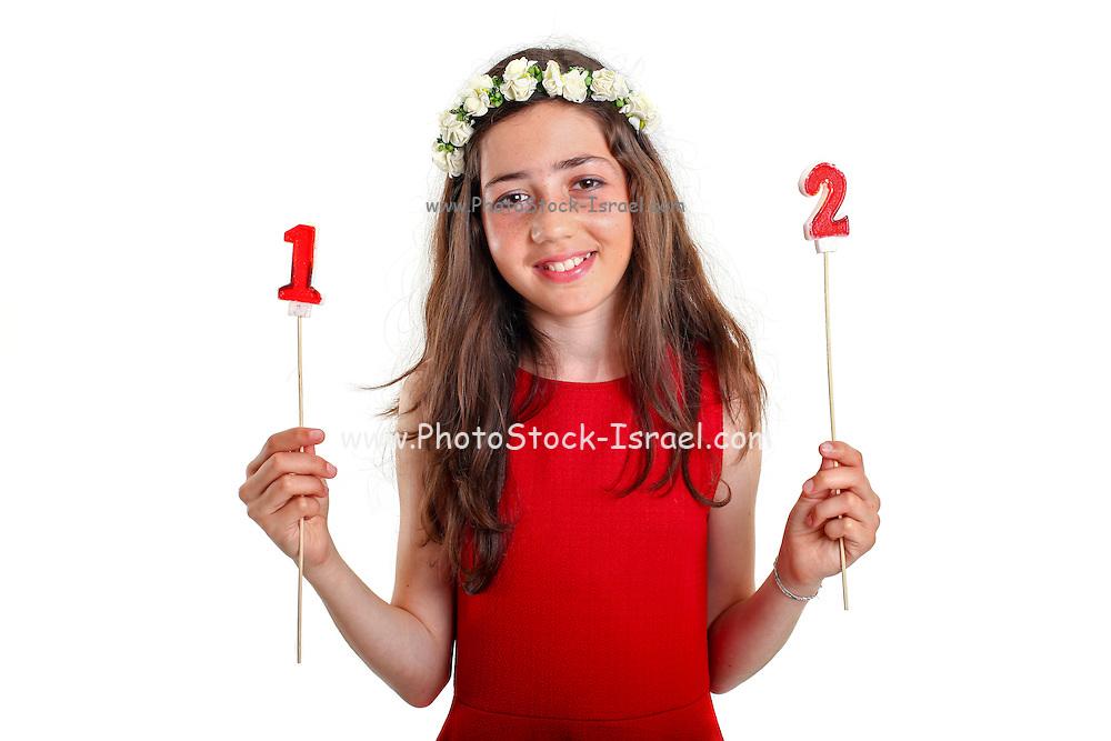 Pre-teen girl in red dress and wreath celebrates twelve