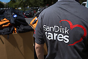 Hundreds of SanDisk employees pack and organize backpacks with school supplies during a backpack drive for Family Giving Tree at the SanDisk headquarters in Milpitas, California, on August 15, 2013. (Stan Olszewski/SOSKIphoto)
