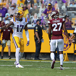 Sep 26, 2020; Baton Rouge, Louisiana, USA; LSU Tigers wide receiver Racey McMath (17) is defended by Mississippi State Bulldogs cornerback Esaias Furdge (27) during the first half at Tiger Stadium. Mandatory Credit: Derick E. Hingle-USA TODAY Sports