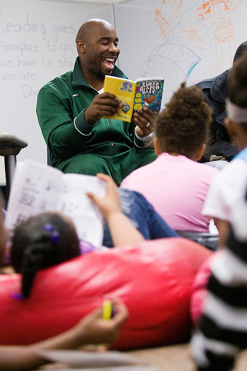 """iMatt Dixon   The Flint Journal..Mateen Cleaves reads """"The Adventures of Super Diaper Baby"""" by Dav Pilkey and George Beard with kids ages seven to twelve at the Boys & Girls Club of Flint, Wednesday evening. Cleaves makes appearances about once a month for Books and Basketball with Mateen Cleaves. Cleaves is a former Flint Northern and Michigan State basketball star who played for the Detroit Pistons and is currently a studio analyst for Fox Sports Detroit."""