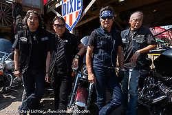 Japanese custom builders Takotoshi Suzuki of Seven Motorcycles and Ken Nagai of Ken's Factory with friends at the the Iron Horse Saloon during the Sturgis Black Hills Motorcycle Rally. Sturgis, SD, USA. Tuesday, August 6, 2019. Photography ©2019 Michael Lichter.