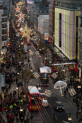 © Licensed to London News Pictures. 17/12/2011. LONDON, UK. Oxford Street seen from above as thousands rush to buy Christmas Presents during the busiest shopping day of the year. Photo credit: Matt Cetti-Roberts/LNP