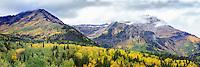 Fall colors cover the backside of Mt. Timpanogos along Utah's Alpine Loop in American Fork Canyon.