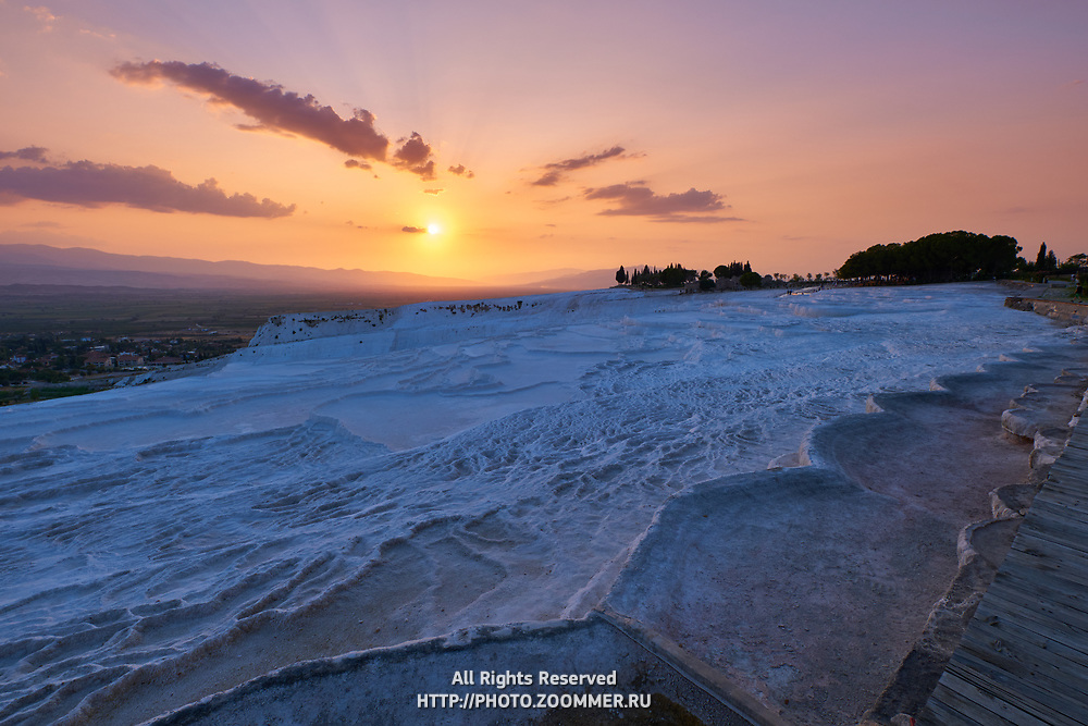 Empty travertine pools at sunset in Pamukkale