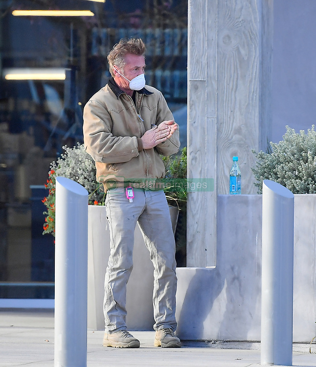 EXCLUSIVE: Sean Penn plays it safe by using some hand sanitizer strapped to his belt before eating a sandwich in Malibu. Sean stopped by a local grocery store and purchased a drink and a sandwich. He was seen wearing a face mask as he shopped the grocery store and had a hand sanitier hanging from his belt. Before enjoying his lunch he was seen applying some and sat alone, socially distancing himself from everyone as he he enjoyed a few bites before heading out. 28 Mar 2020 Pictured: Sean Penn. Photo credit: Marksman/ Snorlax / MEGA TheMegaAgency.com +1 888 505 6342
