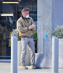 Sean Penn plays it safe by using some hand sanitizer strapped to his belt - 29 March 2020
