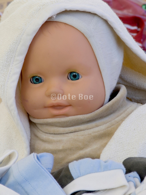 face of a baby doll nicely tucked in
