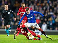 Football - 2019 / 2020 UEFA Europa League - Round of Sixteen, First Leg: Rangers vs. Bayer 04 Leverkusen<br /> <br /> Ryan Kent of Rangers vies with Charles Aranguiz of Bayer Leverkusen, at Ibrox Stadium, Glasgow.<br /> <br /> COLORSPORT/BRUCE WHITE