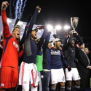 New England Revolution players celebrate their Eastern Conference Final win with the trophy after the New England Revolution Vs New York Red Bulls, MLS Eastern Conference Final, second leg. Gillette Stadium, Foxborough, Massachusetts, USA. 29th November 2014. Photo Tim Clayton