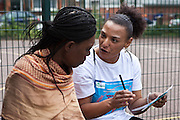 Volunteer Cassandra talking to resident Agnes about th Pathways Project launch by Souther Housing Group, Stamford Hill Estate London. The pathways project is a voluntary information, support and guidance service aimed at young people aged 16-25 years in Hackney.