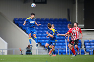 AFC Wimbledon defender Will Nightingale (5) wining header during the EFL Sky Bet League 1 match between AFC Wimbledon and Sunderland at Plough Lane, London, United Kingdom on 16 January 2021.