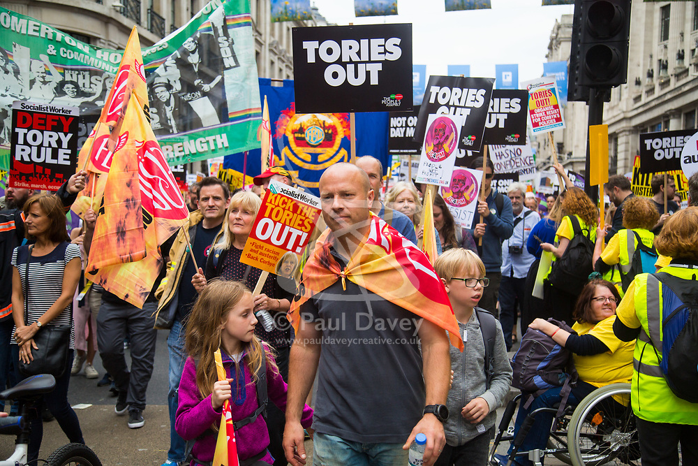 London, July 1st 2017. Anti-Tory protesters march from the BBC's headquarters through the streets of London to Parliament in London following the Conservative Party's £1.5 billion deal with the DUP to enable a slim majority in the House of Commons. PICTURED: Members of the FBU, the Fire Brigades Union march along Regent Street.