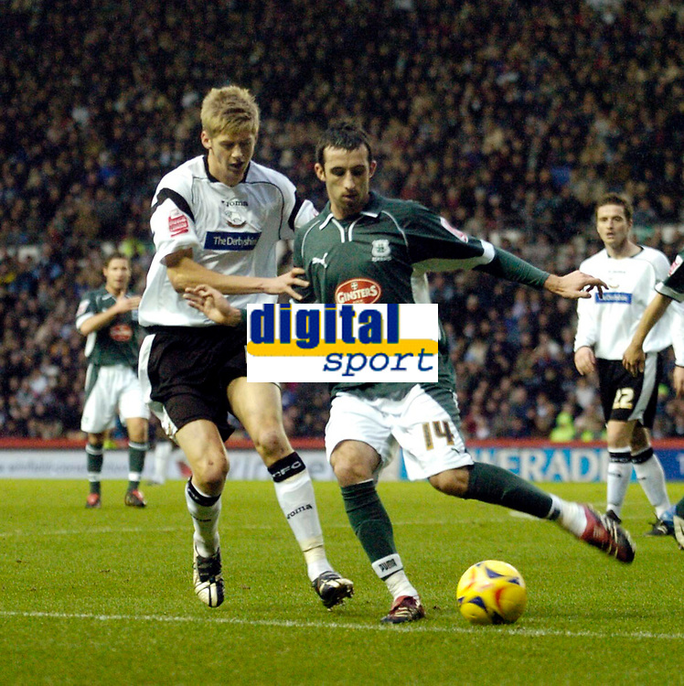 Photo: Leigh Quinnell.<br /> Derby County v Plymouth Argyle. Coca Cola Championship. 30/12/2006. Plymouths Tony Capaldi looks for a way round Derbys Jon Stead.