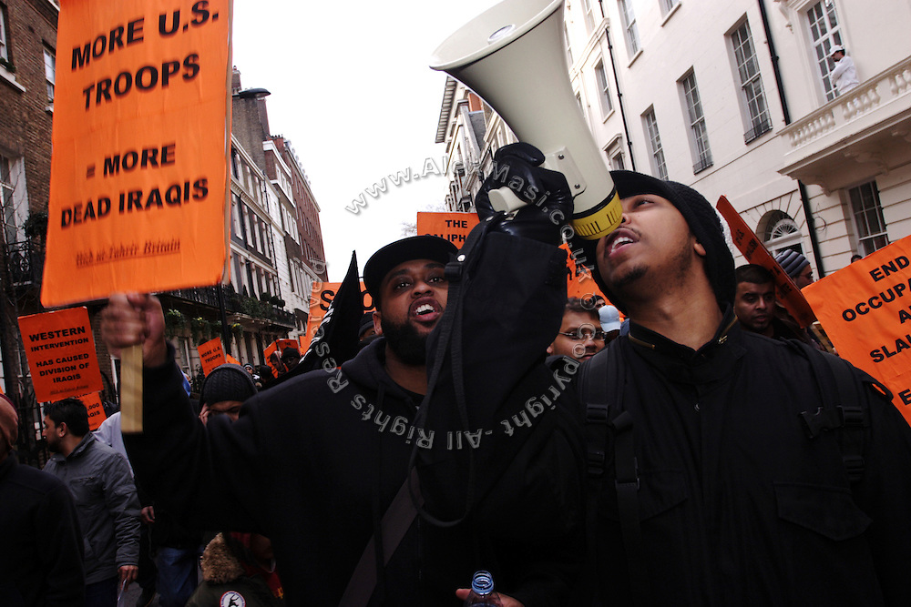 Cataclysm, 27, (left) and Iron Braydz, 26, (right) are taking part to a demonstration against the US-led invasion of Iraq, on Saturday, Jan. 20, 2007, in central London, England. Islamic Hip Hop artists like the duo 'Blind Alphabetz', from London, feel more than ever the need to say what they think aloud. In the music industry the backlash of a disputable Western foreign policy towards Islamic countries and its people is strong. The number of artists in the European Union and the US taking this into consideration and addressing the current social and political problems within their lyrics is growing rapidly and fostering awareness for Muslim and others alike.