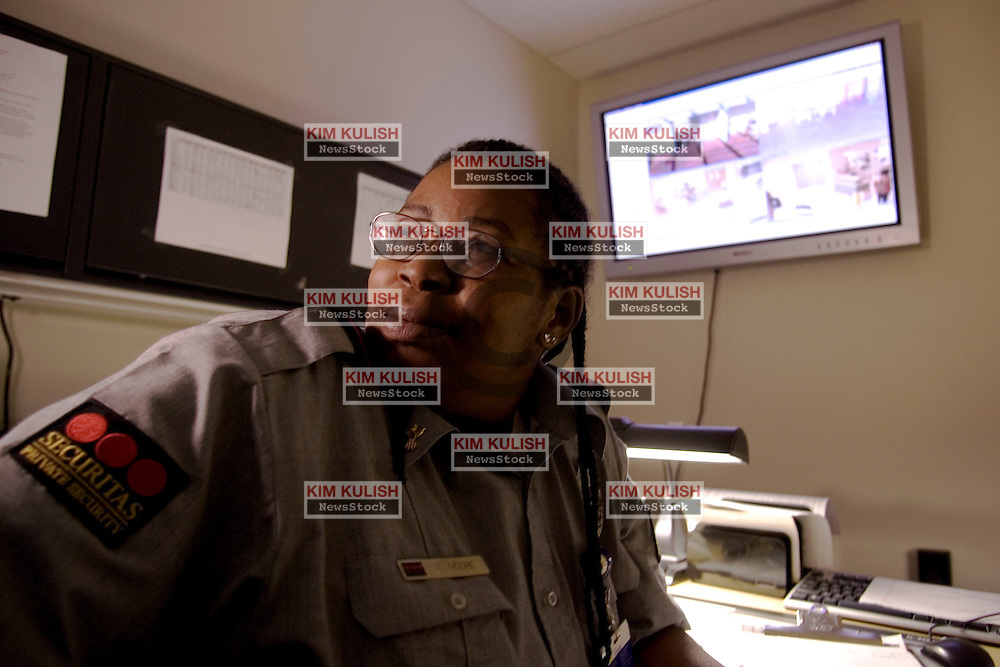 A security officer monitors the video screens at the  San Mateo County Hospital. The County partners with Securitas, an international private security company to better use its resources to protect its citizens. --Photo ©2004  by Kim Kulish