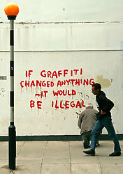 """© London News Pictures. LONDON, UK 26/04/2011. Fitzrovia's Clipstone Street gets a new piece of street art, thought to be by graffiti artist Banksy. This new addition to London comes complete with famous trademark Banksy rat with the wording """"If Graffiti Changed Anything It Would Be Illegal"""" in red paint.  The work appeared over the April Bank Holiday weekend 25/04/2011. Credit line should read: Simon Lamrock/London News Pictures."""