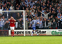 Photo: Dave Linney.<br />Walsall v Huddersfield Town. Coca Cola League 1. 22/04/2006Huddersfield's .Andy Booth celebrates with fans after making it 3-1