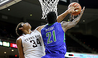 Texas A&M's Tyler Davis (34) is called for a foul while trying to block a shot by Florida Gulf Coast University's Demetris Morant (21) during a NCAA college basketball game in College Station, Texas, Wednesday, Dec. 2, 2015.  (AP Photo/Sam Craft)