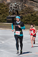 """KASIA HEFFLEFINGER   of West Point, New York runs up a  hill during the West Point Half-Marathon Fallen Comrades Run at the United States Military Academy in West Point, New York. The monument """"To the American Soldier"""" is in the background. The nine-foot bronze statue was sculpted by Felix de Weldon, who also did the Iwo Jima Statue at Arlington National Cemetery."""