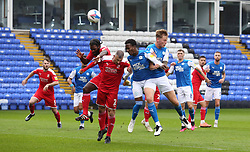 Siriki Dembele and Frankie Kent of Peterborough United challenge for the ball with Anthony Grant and Paul Caddis of Swindon Town - Mandatory by-line: Joe Dent/JMP - 03/10/2020 - FOOTBALL - Weston Homes Stadium - Peterborough, England - Peterborough United v Swindon Town - Sky Bet League One