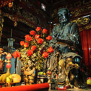 An ornate shrine in a side chapel at Tran Quoc Pagoda on a small island on West Lake (Ho Tay). Originally built in the 6th century on the banks of the Red River, a changing course of the river forced the pagoda to be relocated in 1615 to Golden Fish (Kim Ngu) islet on the lake.