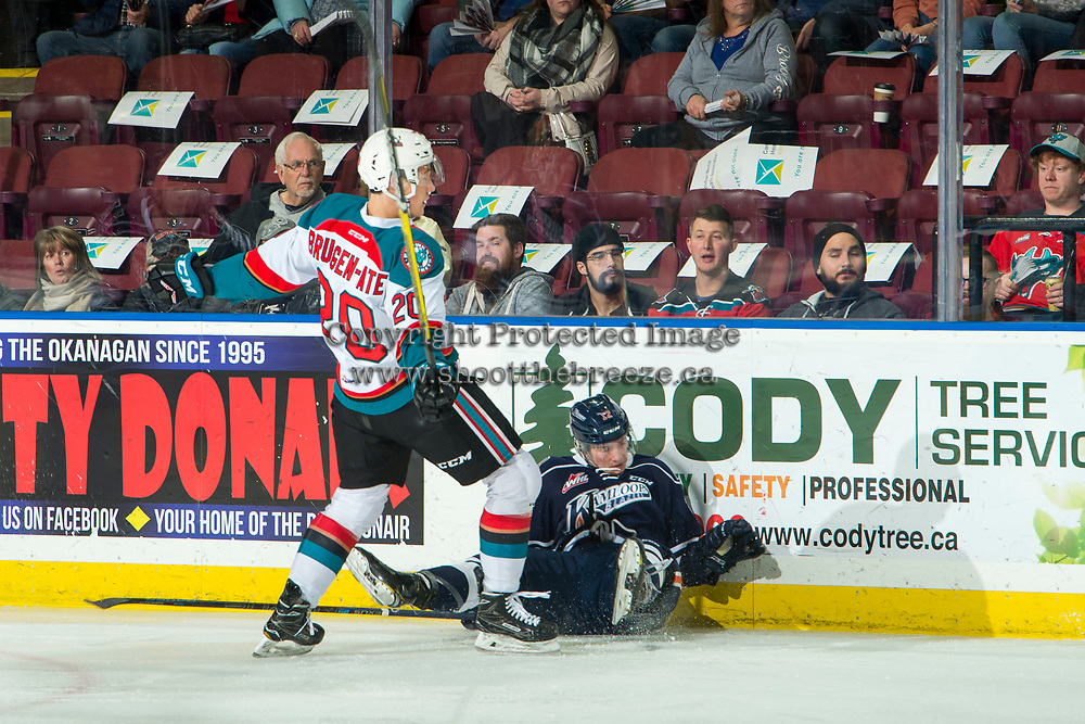 KELOWNA, CANADA - FEBRUARY 2: Conner Bruggen-Cate #20 of the Kelowna Rockets checks Martin Lang #22 of the Kamloops Blazers at the boards during first period  on February 2, 2019 at Prospera Place in Kelowna, British Columbia, Canada.  (Photo by Marissa Baecker/Shoot the Breeze)