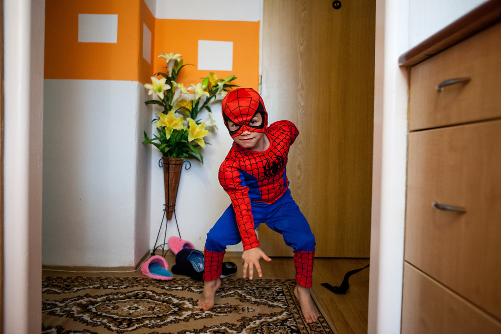 Visiting the family of Jitka Cervenakova (25) who is the mother of Sarlota Kroscen (6) and Sebastian Kroscen (4), who is dressed as spiderman in that image. Jitka is also a volunteer supporting other mothers with knowledge and explaining legal rights for getting their children into mainstream schools in the city of Ostrava, where Roma and non Roma children are educated together.